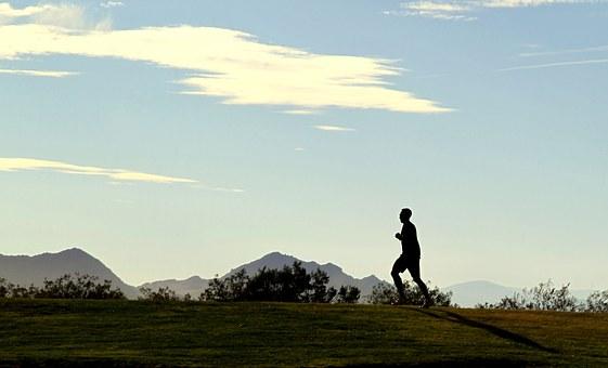 man-running-on-hill